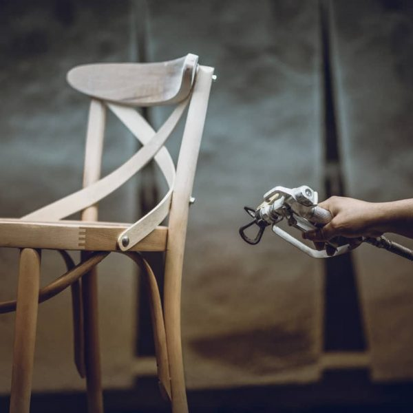 Carpenter Painting And Lacquering His Newly Made Chair